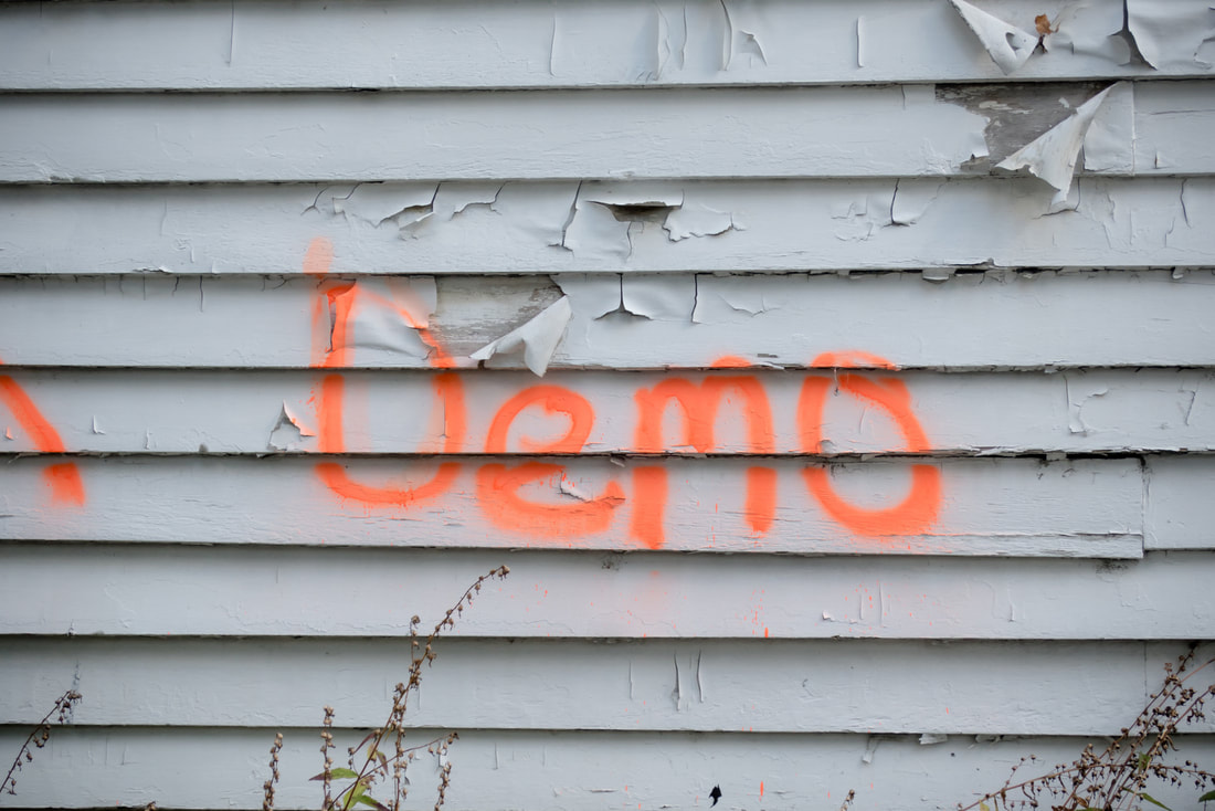 Building with the word demo sprayed on it in New Oreans